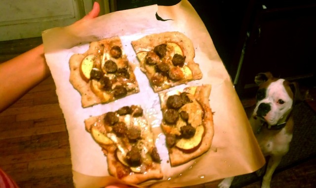 Nory drools over the artisanal bison sausage, peach, and goat cheese pizza, fresh from the oven
