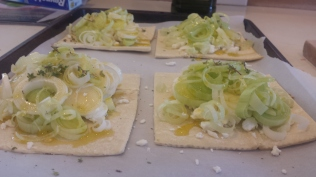 Leek and goat cheese puff-pastry tarts prepared and ready for the oven.