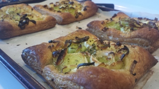 Cooked goat cheese and leek tarts.
